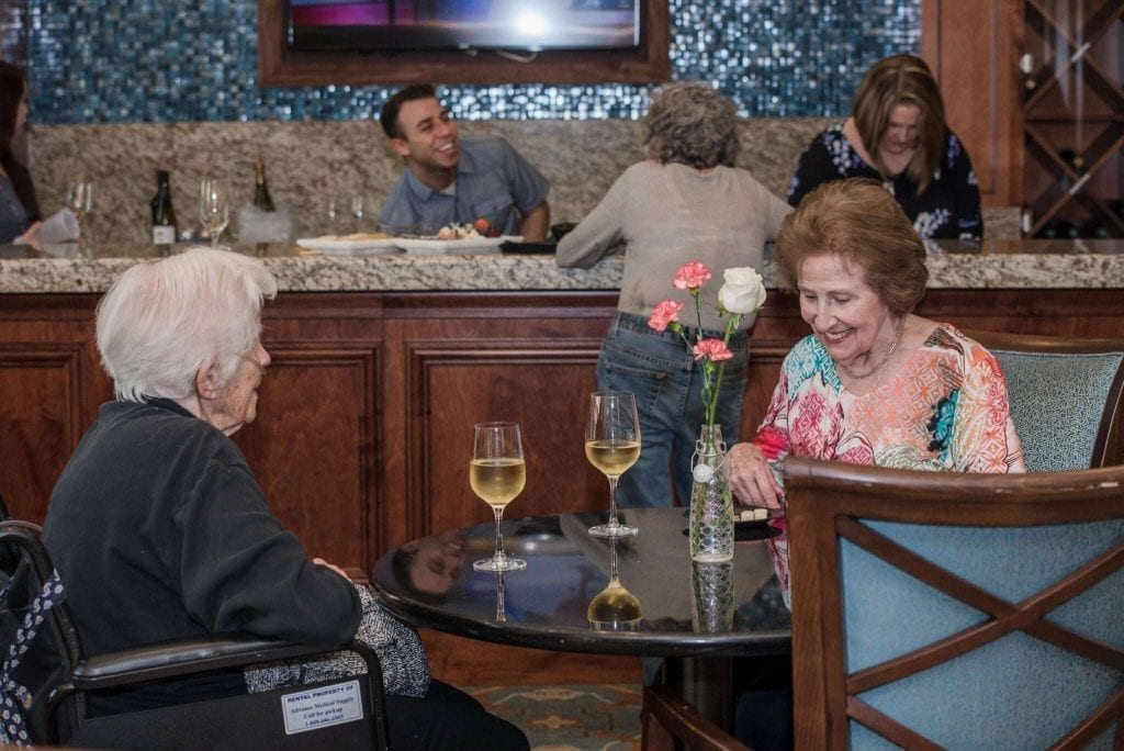 An image of two Waterstone on Augusta residents enjoying drinks.