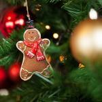 Smiling gingerbread ornament hanging on tree