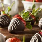Chocolate-covered strawberries on wood cutting board